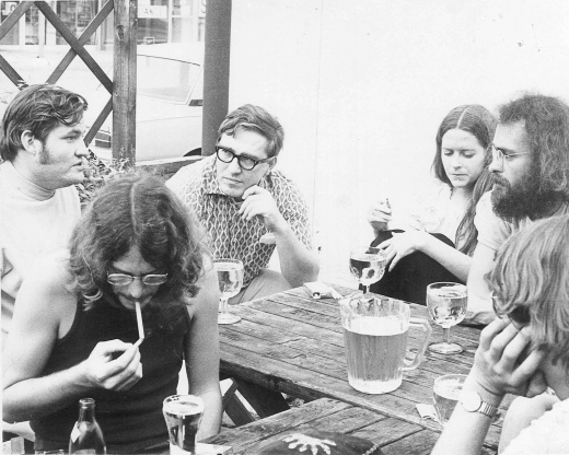 A Saturday afternoon at the Quiet Man pub in Dallas circa 1970. The author is the fellow in the center with horn-rimmed spectacles and a civilized haircut.